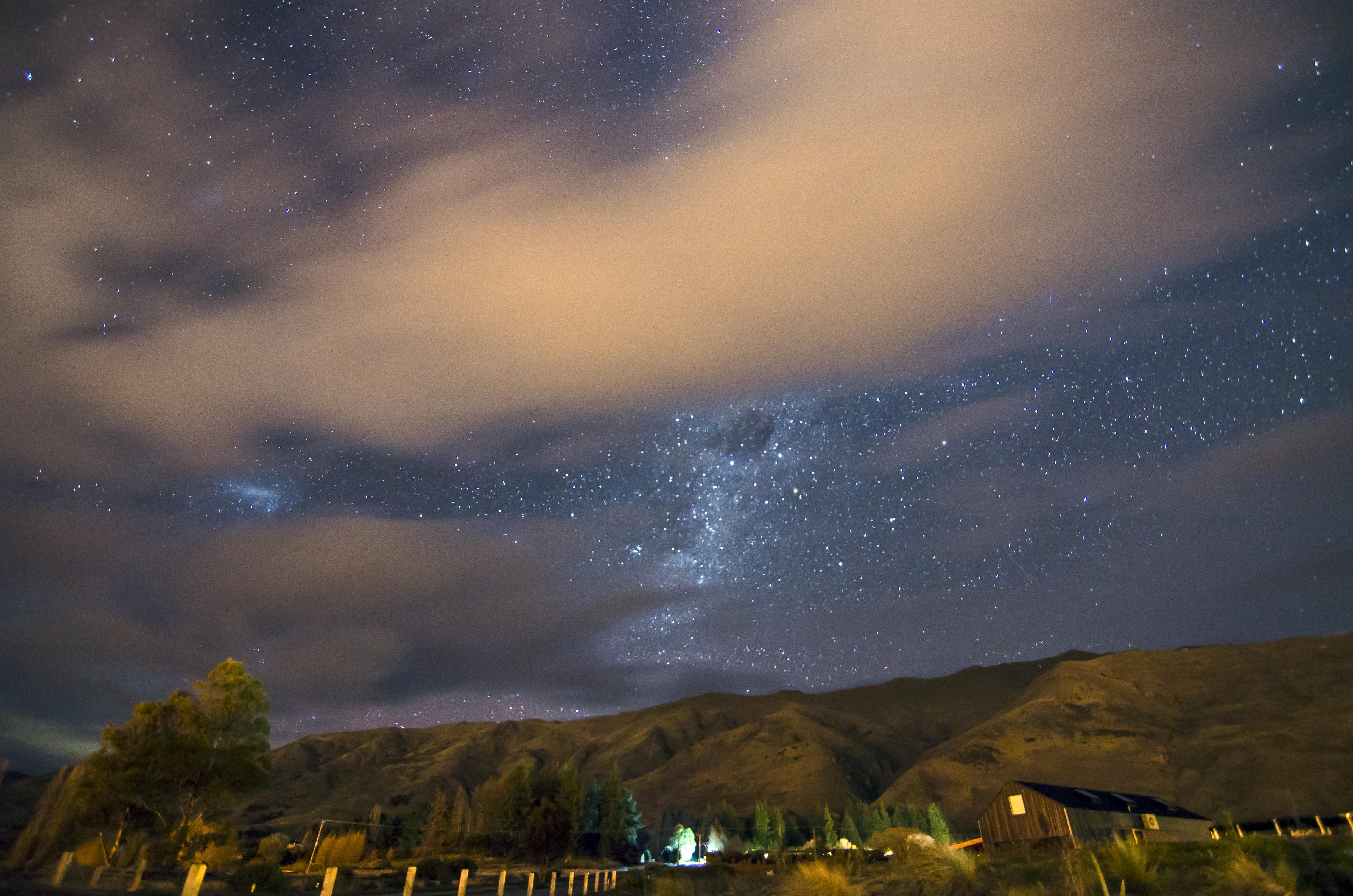 Cloudy Night Sky Stars Star trails   O...